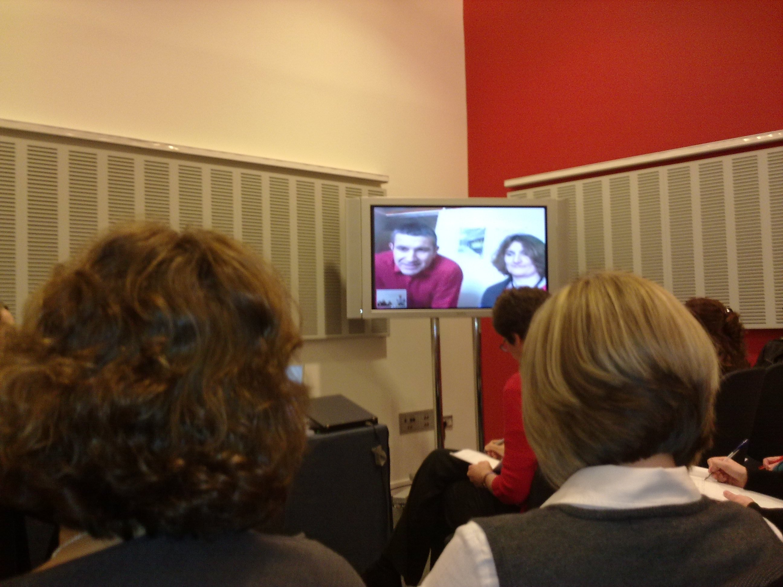 Image01621 simultaneously talk to each other through the use of a web cam and ...